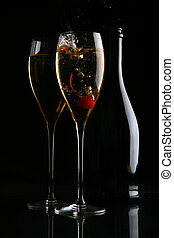 two elegant glasses with gold champagne