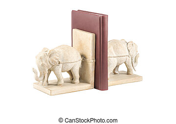 two elephant figurines hold a book