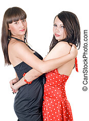Two embracing beauty young women. Isolated on a white background