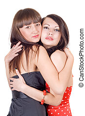 Two embracing beauty young women. Isolated on a white