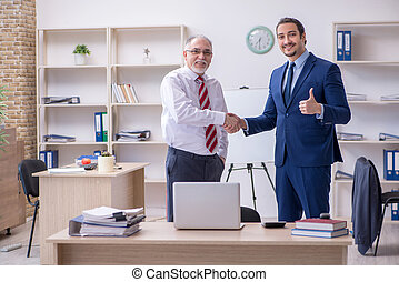 Two employees in the office