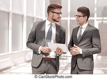 two employees standing in the office