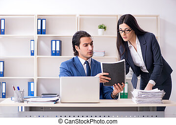 Two employees working in the office