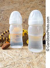 Two empty baby bottles