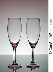 Two empty glasses for champagne