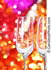 Two empty glasses on the blurred background