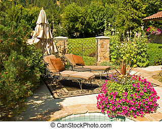 Two Empty Lounge Chairs in a Garden Setting