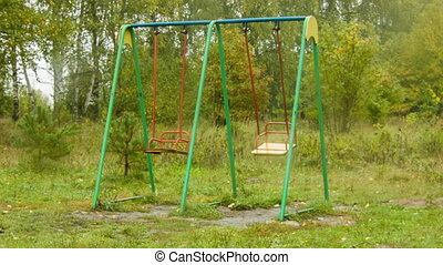 Two empty swing shakes on playground