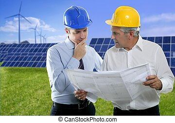 architect engineer two expertise team plan talking hardhat solar plates meadow grass