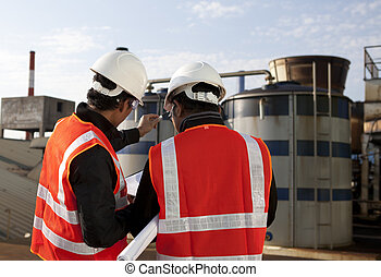 two engineer on location site disscution