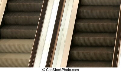 Two escalators in shopping centre which move up one another...