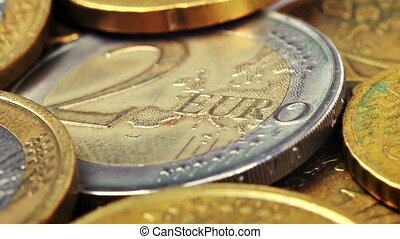Two Euro coin and many coins, close up