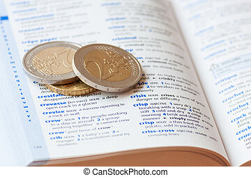 Two euro coins in dictionary