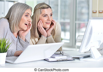 women using laptop and computer