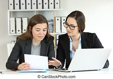 Two executives working together at workplace