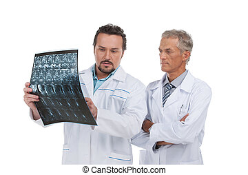 Two experienced doctors discussing X-ray. Standing isolated on white