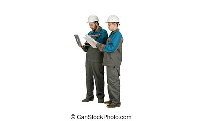 Two experienced industrial technicians work on laptop on white background.