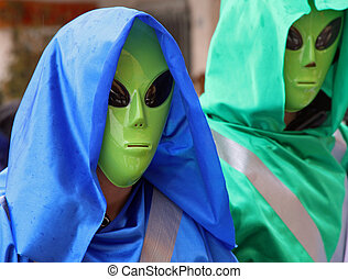 two extraterrestrial landed on the ground with large eyes and green face