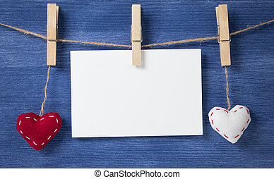 two fabric hearts on wooden background