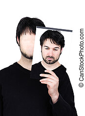 two faces thoughtful - symbolic image of a man holding his ...