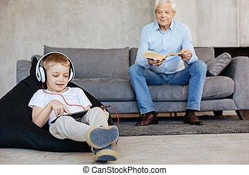 Two family generations enjoying similar hobbies