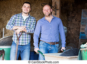 Two farm workers in hayloft - Two handsome farm workers...