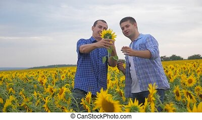 two farmers men business photographing on a smartphone...