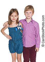 Two fashion children against the white