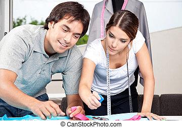 Two Fashion Designer Working Together