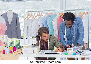 Two fashion designers working together