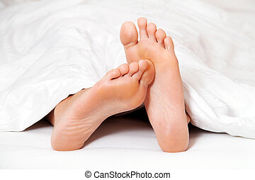 feet in bed