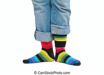 Two feet in multi-coloured socks