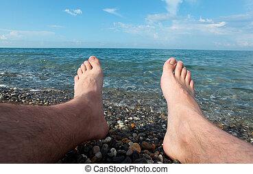 two feet on pebble beach