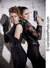 Two female agents with guns