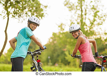 Two Female Caucasian Cyclists