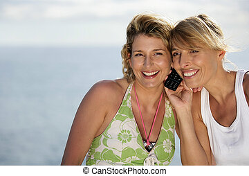 Two female friends at the beach