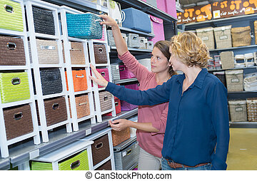 two female friends buying at a store