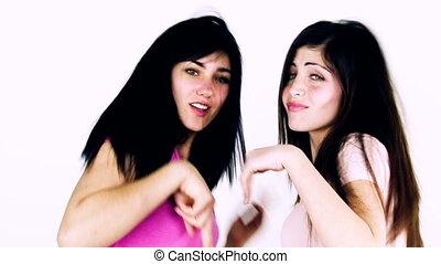 Two female friends dancing happy