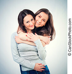 two female friends hugging