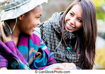 Two female friends looking at each other