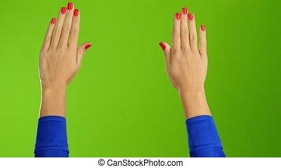 Two female hands waving hello or goodbye. Green screen...
