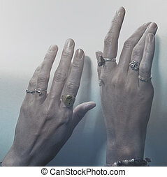 Two female hands with rings