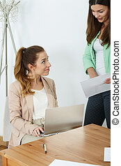 Two female office workers