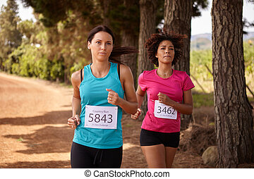 Two female runners in a race