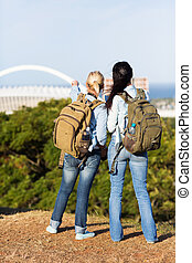 two female travellers touring Durban, south africa - two...