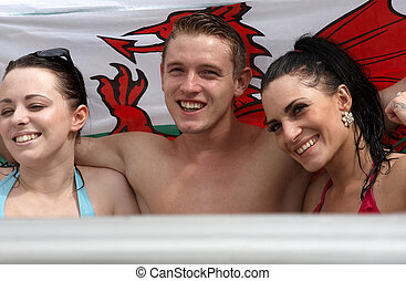 Two females and one male in a jacuzzi