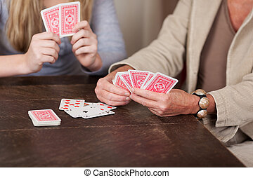 Two females playing cards