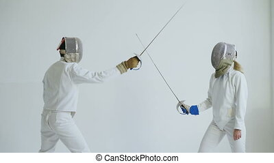 Two fencers having training attack and defence exercises in...