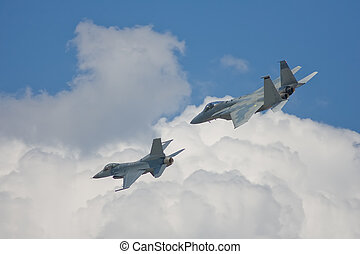 Two fighter jets do a flyby during an airshow - A F-16...
