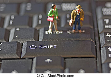 Two Figures on Keyboard